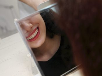 Woman smiling towards mirror