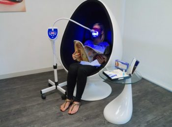 Woman reading while doing the treatment