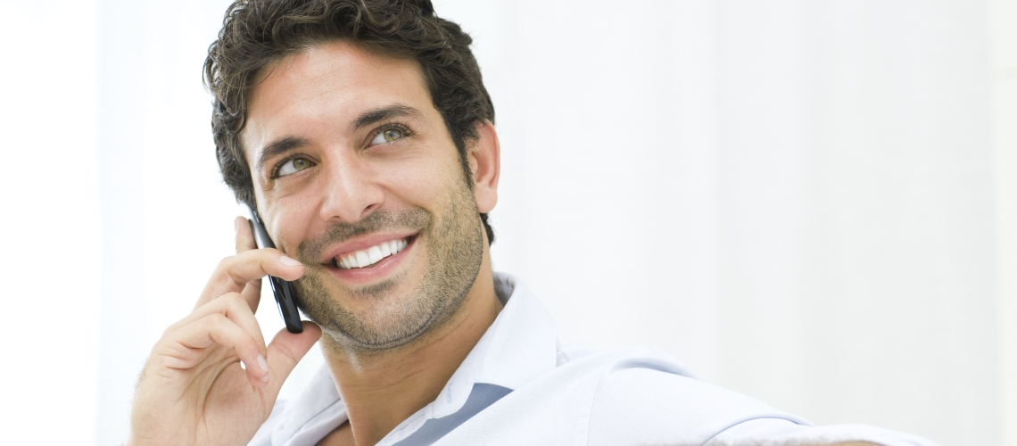 man smiling on the phone