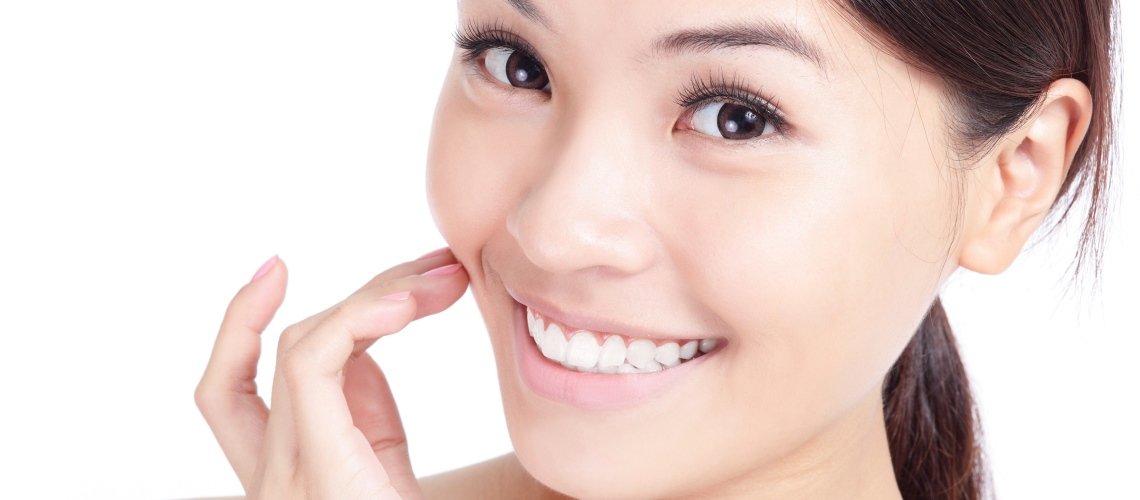 Smiling Asian woman with white teeth